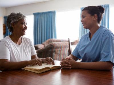 nurse and senior woman having a conversation