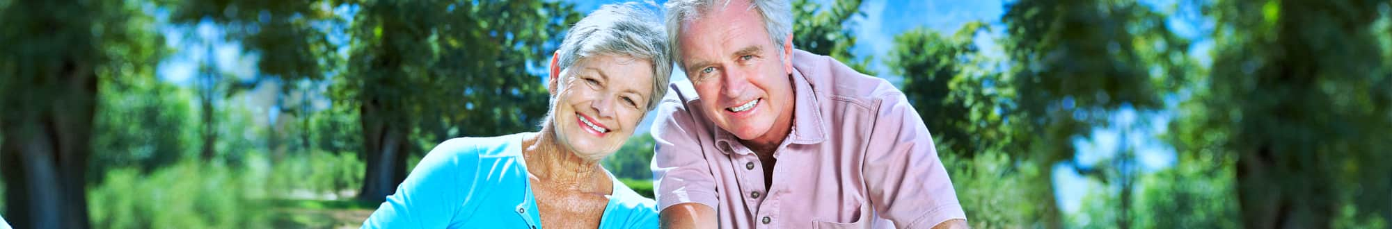 two elderly couple smiling
